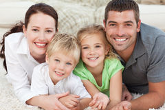 Happy family lying on the floor Stock Photo