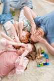 Happy family lying on floor, big family portrait concept Royalty Free Stock Photography