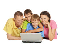 Happy family lying Stock Image