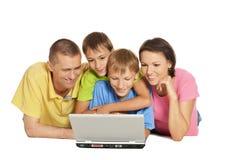 Happy family lying Stock Image
