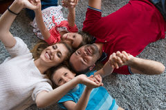 Happy family lying on the floor Royalty Free Stock Photography