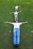 Happy family lying on the grass. Happy asian family lying on the grass Royalty Free Stock Image