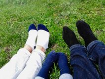 Happy family lying in the grass field in park royalty free stock photos