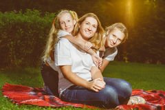 Happy family lying on the grass in summer. Picnic Stock Photos