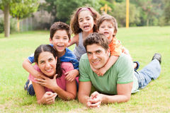 Happy family lying in the park Royalty Free Stock Images