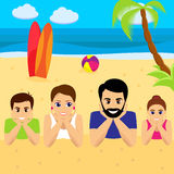 Happy family lying on sand together smiling. Royalty Free Stock Image