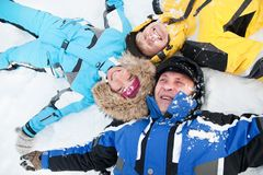 Happy family lying on a snow Royalty Free Stock Photography