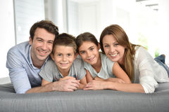 Happy family lying on sofa Royalty Free Stock Image