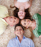 Happy family lying  with their head Stock Images