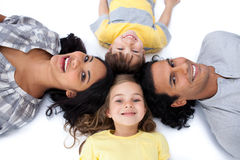 Happy family lying together on the floor in circle Stock Image
