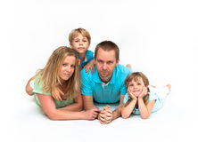 Happy family lying together. Happy family lying next to each other on a floor Stock Images
