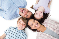 Happy family lying on white background Royalty Free Stock Images