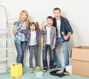 Happy family makes repairs at home Stock Photo