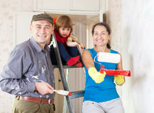 Happy family makes repairs at home Royalty Free Stock Photos