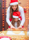 Happy family making Christmas cookies Royalty Free Stock Image
