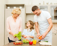 Happy family making dinner in kitchen Royalty Free Stock Image