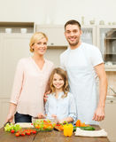 Happy family making dinner in kitchen Stock Photo