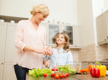 Happy family making dinner in kitchen Stock Photography