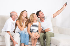 Happy family making a selfie with a phone. Family with elderly children making a selfie with a phone Royalty Free Stock Photo