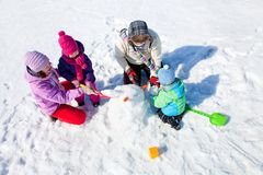 Happy family making snowman Stock Photography