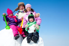 Happy family making snowman Royalty Free Stock Image