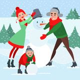 Happy Family Making Snowman. Winter Holidays. Christmas Time Royalty Free Stock Images