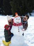Happy family making snowman Stock Photo