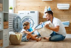 Free Happy Family Man Father Householder And Child In Laundry With Royalty Free Stock Image - 107835086