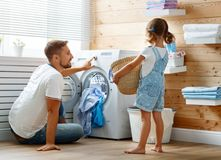 Free Happy Family Man Father Householder And Child In Laundry With Royalty Free Stock Photos - 108513808