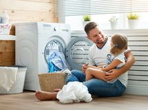 Happy family man father householder and child   in laundry with Stock Photos
