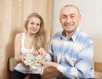 Happy  family with many US dollars Royalty Free Stock Photo