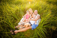 Happy family on a meadow Royalty Free Stock Images
