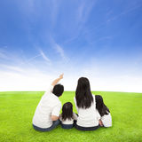 Happy family on a meadow with cloud background royalty free stock photography