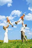 Happy family on meadow Royalty Free Stock Photo