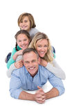 Happy family members lying on each other Stock Photo
