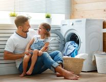 Happy family man father householder and child in laundry with royalty free stock photos