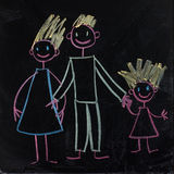 Happy family (Mom, Dad, baby.). Cute doodles on blackboard Royalty Free Stock Photo