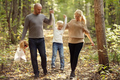Happy family mom dad and daughter walking in the park Royalty Free Stock Photo