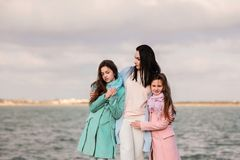 Happy family, mom and daughters stock image