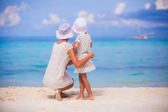 Happy family of mom and kid on summer vacation. Young beautiful mother and her adorable little daughter have fun at tropical beach Royalty Free Stock Photos