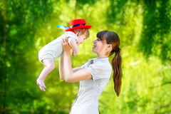 Happy family, mom and little son having fun in the park. Summer Royalty Free Stock Image