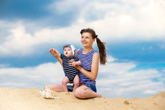Happy family, mom and little son in striped vests having fun  in Stock Photo