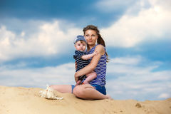 Happy family, mom and little son in striped vests having fun  in Stock Image