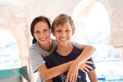 Happy family mom and son smile in the arms royalty free stock photo
