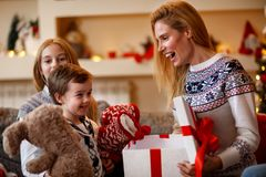 happy family moments –family at Christmas opening gifts together. royalty free stock image
