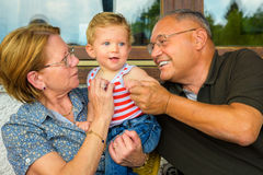 Happy family moments. Family moment,Grandparents having great fun with their grandchild Stock Image