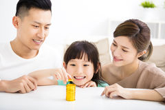 Happy family money saving concept. Happy asian family money saving concept stock photos