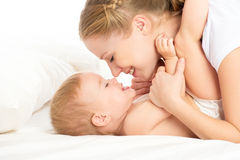 Free Happy Family Mother And Baby Having Fun Playing, Laughing On Bed Stock Image - 35304611