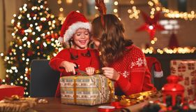 Happy Family Mother And Child Pack Christmas Gifts Royalty Free Stock Photo