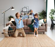 Free Happy Family Mother And Child Play At Home And Sing With Combs Royalty Free Stock Photo - 138125645